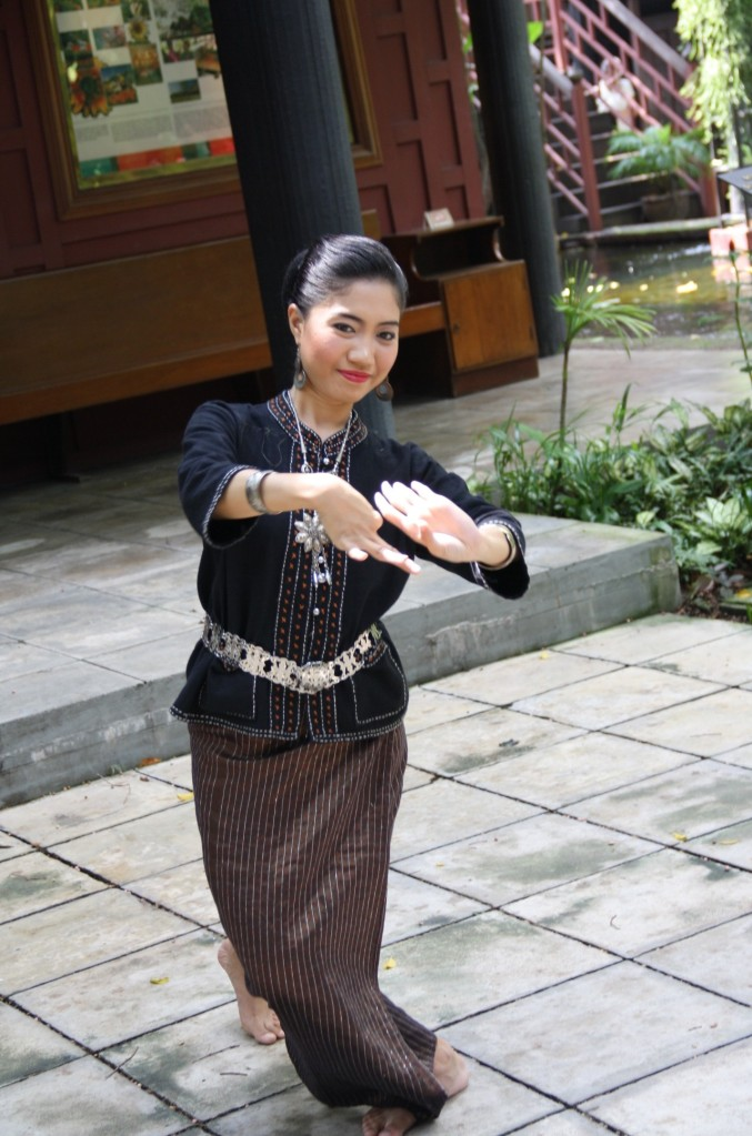 Thai woman dancing to a traditional song.