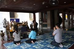 People praying outside